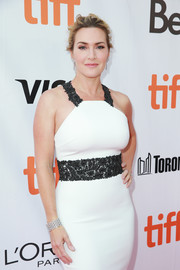 Kate Winslet paired a gorgeous diamond cuff by De Beers with a monochrome halter dress for the TIFF premiere of 'The Mountain Between Us.'