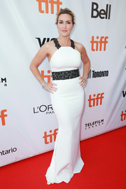 Kate Winslet worked her curves in a white Badgley Mischka halter gown with black lace detail at the TIFF premiere of 'The Mountain Between Us.'