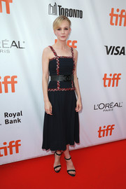 Carey Mulligan kept it breezy yet elegant in a black Chanel midi dress with tweed trim at the TIFF premiere of 'Mudbound.'