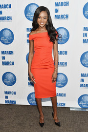 Deshauna Barber donned an orange off-the-shoulder dress from Karen Millen for the UN Women for Peace Association luncheon.