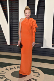 Malin Akerman wore an orange one-sleeve gown with ruffle detailing to the Vanity Fair Oscar party.