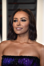 Kat Graham wore her hair short and slightly wavy when she attended the Vanity Fair Oscar party.