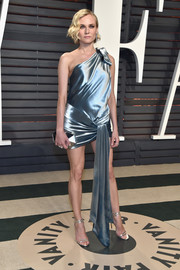 Diane Kruger kept the shine going with a mirrored silver clutch.