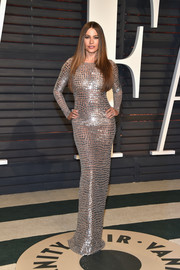 Sofia Vergara sheathed her famous curves in a skintight silver gown by Michael Kors for the Vanity Fair Oscar party.