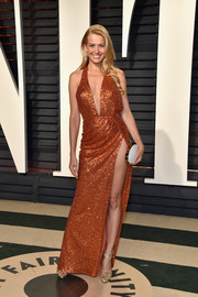 Petra Nemcova teamed her dress with a pair of gold cross-strap sandals.