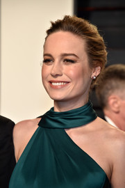 Brie Larson attended the Vanity Fair Oscar party wearing her hair in a slightly messy bun.