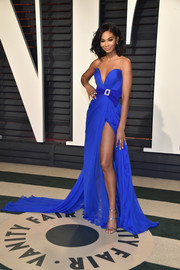 Chanel Iman looked mesmerizing in an electric-blue strapless gown by Zuhair Murad Couture, boasting a plunging sweetheart neckline, a bejeweled belt, and a thigh-high slit, at the Vanity Fair Oscar party.