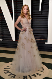 Leslie Mann looked ethereal in a nude Carolina Herrera tulle gown with gold leaf embroidery during the Vanity Fair Oscar party.