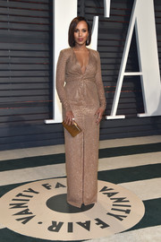 Kerry Washington was all about refined elegance in a beaded gold Michael Kors gown with a cinched-in waist and a front slit during the Vanity Fair Oscar party.