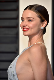 Miranda Kerr styled her hair into a simple chignon for the Vanity Fair Oscar party.