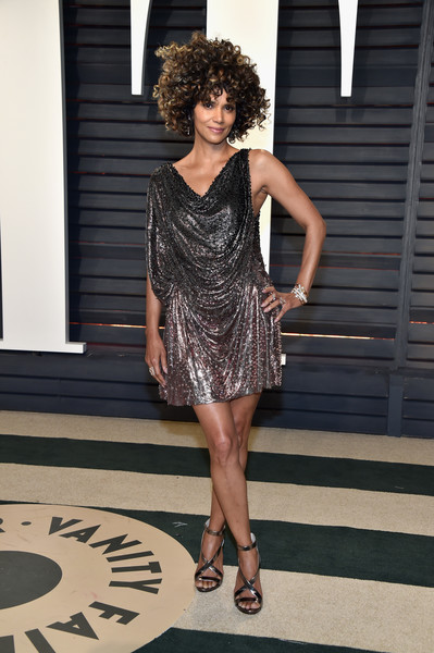 Halle Berry looked disco-ready in a draped ombre chainmail dress by Atelier Versace at the Vanity Fair Oscar party.