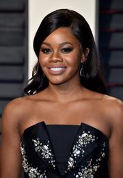 Gabrielle Douglas kept it girly with this loose wavy style at the Vanity Fair Oscar party.