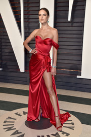 Alessandra Ambrosio ravished in a high-slit red corset gown by Ralph & Russo Couture at the Vanity Fair Oscar party.