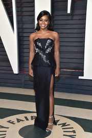 Gabrielle Douglas got glam in strapless black gown by Thomas Wylde, featuring a bejeweled bodice and a peplum waist, for the Vanity Fair Oscar party.