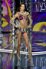 Lais Ribeiro rocked purple lingerie teamed with tribal-inspired accessories at the 2017 Victoria's Secret fashion show.