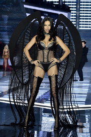 Adriana Lima got majorly vampy in a black fishnet bodysuit with lace-up detailing for the 2017 Victoria's Secret fashion show.