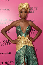 Maria Borges teamed an oversized gold belt with a strapless green dress, both by Tiffany Amber Culture, for the 2017 Victoria's Secret fashion show after-party.
