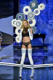 A pair of porcelain-print thigh-high boots and matching gloves sealed off Stella Maxwell's look.