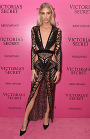 Devon Windsor left little to the imagination wearing this black multi-cutout dress by Julien Macdonald at the 2017 Victoria's Secret fashion show after-party.