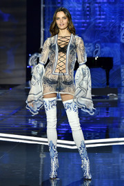 Barbara Fialho walked the 2017 Victoria's Secret fashion show wearing a sheer porcelain-print tunic with a lace-up front and bell sleeves.