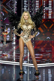 A pair of feathered cutout boots by Brian Atwood completed Romee Strijd's look.