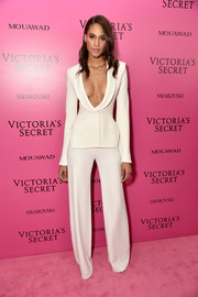 Even with that plunging neckline, Cindy Bruna's white Brandon Maxwell suit was one of the more modest looks at the 2017 Victoria's Secret fashion show after-party.