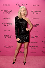 Karlie Kloss slipped into a one-sleeve black sequin dress by RtA for the 2017 Victoria's Secret fashion show after-party.