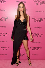 Alessandra Ambrosio went the vampy route in an asymmetrical black wrap dress by Versace at the 2017 Victoria's Secret fashion show after-party.