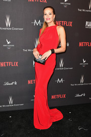 Petra Nemcova attended the Weinstein Company Golden Globes after-party wearing a sleek red one-sleeve gown by The 2nd Skin Co.