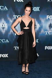 Katie Aselton was modern and sexy in a plunging black cutout dress at the 2017 Winter TCA Tour Fox All-Star Party.