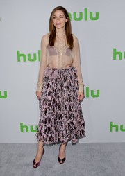 For her footwear, Michelle Monaghan chose elegant purple satin peep-toes.