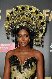Naomi Campbell looked beauty pageant-ready wearing this stunning headdress by Eric Javits at the 2017 amfAR Fabulous Fund Fair.