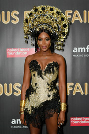 Naomi Campbell attended the 2017 amfAR Fabulous Fund Fair wearing a ton of gold cuff bracelets.