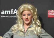 Ellie Goulding wore a voluminous blonde wig to channel Dolly Parton for the 2017 amfAR Fabulous Fund Fair.