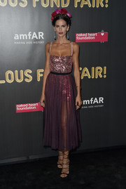 Izabel Goulart sparkled in a purple Dior dress with a disco ball-inspired bodice at the 2017 amfAR Fabulous Fund Fair.