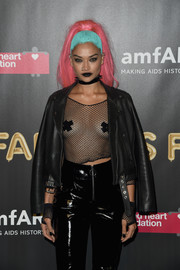 Shanina Shaik left little to the imagination when she wore this fishnet top and pasties combo at the 2017 amfAR Fabulous Fund Fair.