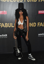 Imaan Hammam gave quite a good impression of Slash as a bombshell in this black vest and white crop-top combo at the 2017 amfAR Fabulous Fund Fair.