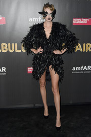 Lindsay Ellingson attended the 2017 amfAR Fabulous Fund Fair wearing a short black feather dress.