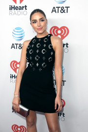 Olivia Culpo went the ultra-modern route with this silver clutch and metal-embellished LBD combo at the iHeartCountry Festival.