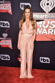 JoJo Fletcher hit the 2017 iHeartRadio Music Awards wearing a plunging pink bodysuit from The Jetset Diaries.