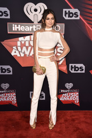 Daya flashed some skin in a white peekaboo jumpsuit by Balmain at the 2017 iHeartRadio Music Awards.