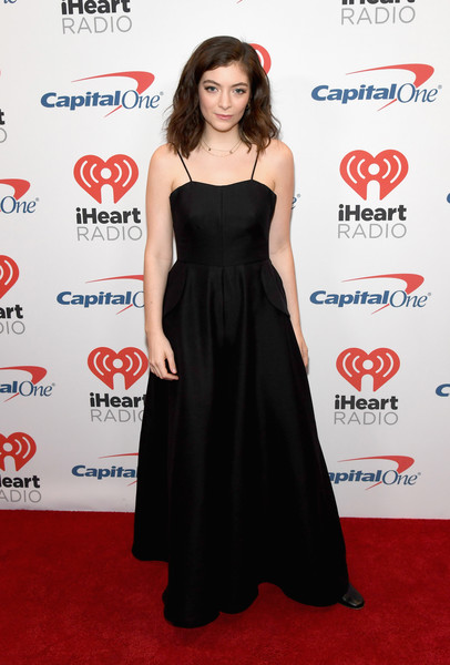 Lorde posed backstage at the 2017 iHeartRadio Music Festival wearing a black spaghetti-strap maxi dress.