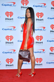 Keke Palmer paired a Louis Vuitton monogram purse with a red-hot latex dress for night 2 of the 2017 iHeartRadio Music Festival.