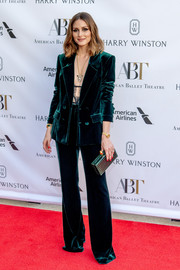 Olivia Palermo matched her suit with a green croc-embossed box clutch.