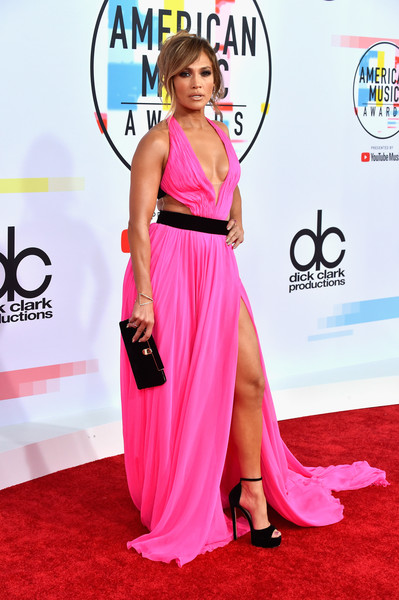 Jennifer Lopez looked ravishing in a hot-pink halter gown by Georges Chakra Couture at the 2018 American Music Awards.