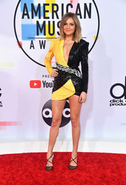 Kelsea Ballerini looked sharp and sexy in a sequined tuxedo dress by Nicolas Jebran at the 2018 American Music Awards.