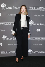 Olivia Wilde teamed a black Givenchy pantsuit with a white ruffle blouse for the 2018 Baby2Baby Gala.