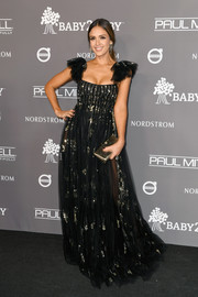 Jessica Alba looked marvelous in a black Valentino gown with gold trim at the 2018 Baby2Baby Gala.