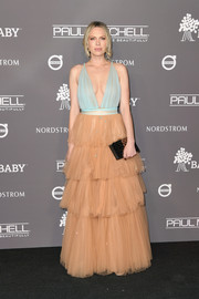 Erin Foster paired her lovely dress with a patterned gold clutch.