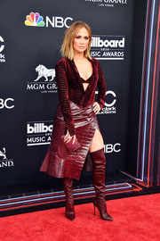 Jennifer Lopez rocked a wine-red velvet button-down and a matching bra by Roberto Cavalli at the 2018 Billboard Music Awards.